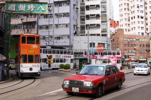 Three Hong Kong trams await departure time from the Shau Kei Wan terminus