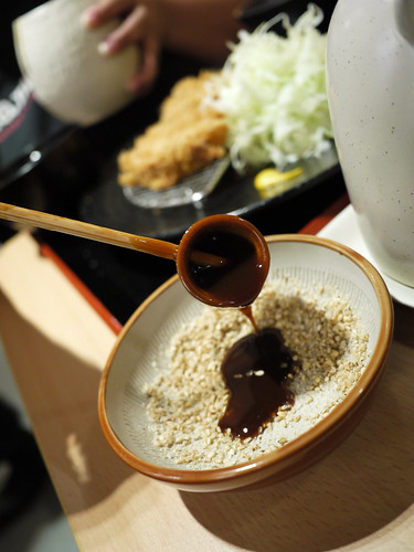 Pouring the Tonkatsu Sauce at Yabu