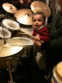 Cute baby plays drums