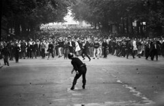 Police hurl grenade at student protesters, Boulevard Saint-Michel, Paris, 1968, by Goksin Sipahioglu