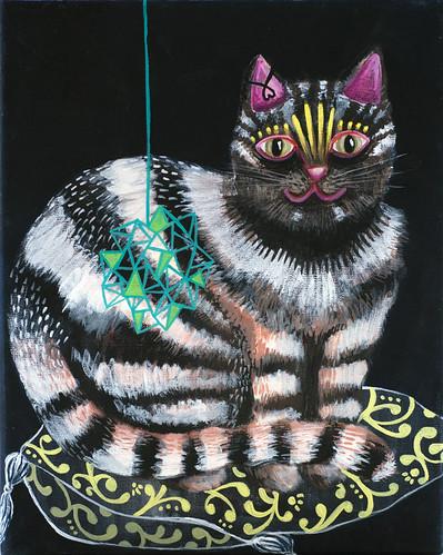 Gato con amuleto