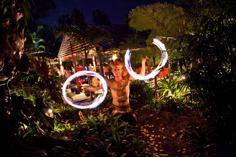 our fire dancers light the way in through the garden