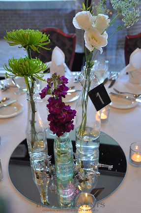 Vintage bottle centerpieces with keys