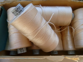 Spools of silk thread (storebukkebruse/Flickr)