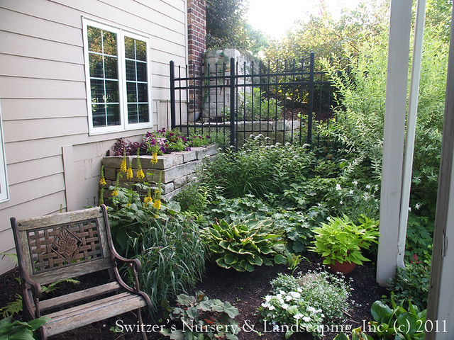 The space under the deck can become some of the most beautiful space in the yard. The perfect place to add a place to sit and relax. On a hot day this shade garden under the deck is just an awesome spot to take a break.