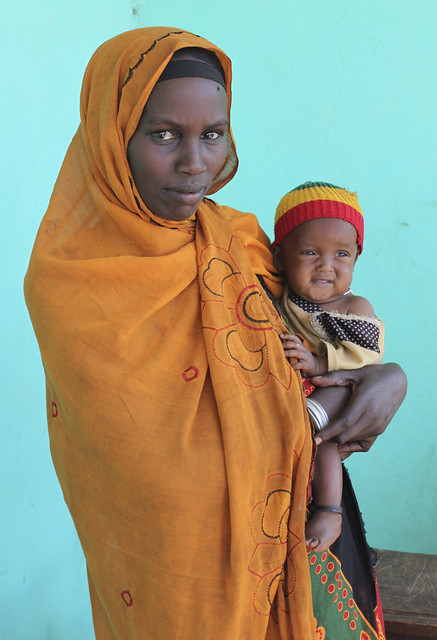 Tiru with her baby daughter, receiving nutrition support in southern Ethiopia, thanks to CARE International