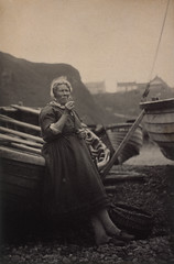 'At Auchmithie 1881,' Woman leaning against boat, 1881, by James Cox