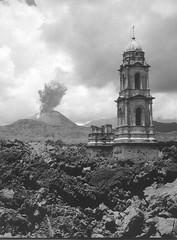 Paricutin volcano and the church of Parangaricutiro buried by the lava, Mexico, 1945-46, by Juan Rulfo