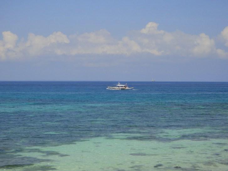 Fishing boat in blue ocean water