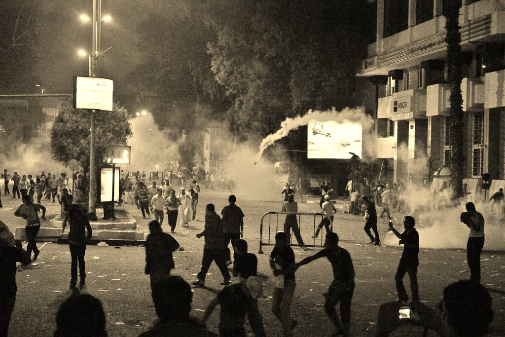 rain of tear gas bombs at protesters at Nahdet Masr Square | وابل من قنابل الغاز على المتظاهرين في ميدان نهضة مصر