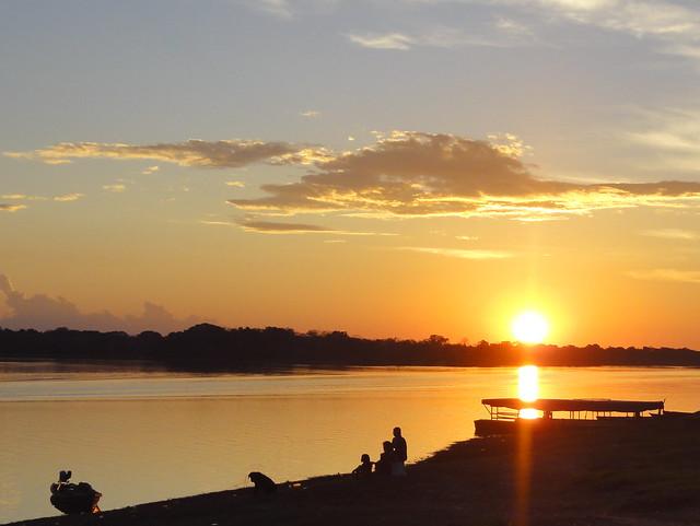 The sun sets over Rio Loretoyaco