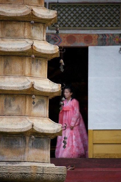 Girl in Pink Dress at Temple