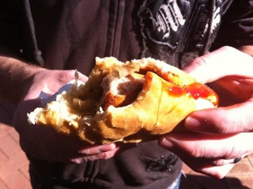 burger boy demolishes his Bratwurst at the Subiaco Farmers Market
