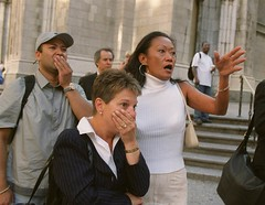 People in front of New York's St. Patrick's Cathedral react with horror as they look down Fifth Ave toward the burning World Trade Center, by Marty Lederhandler