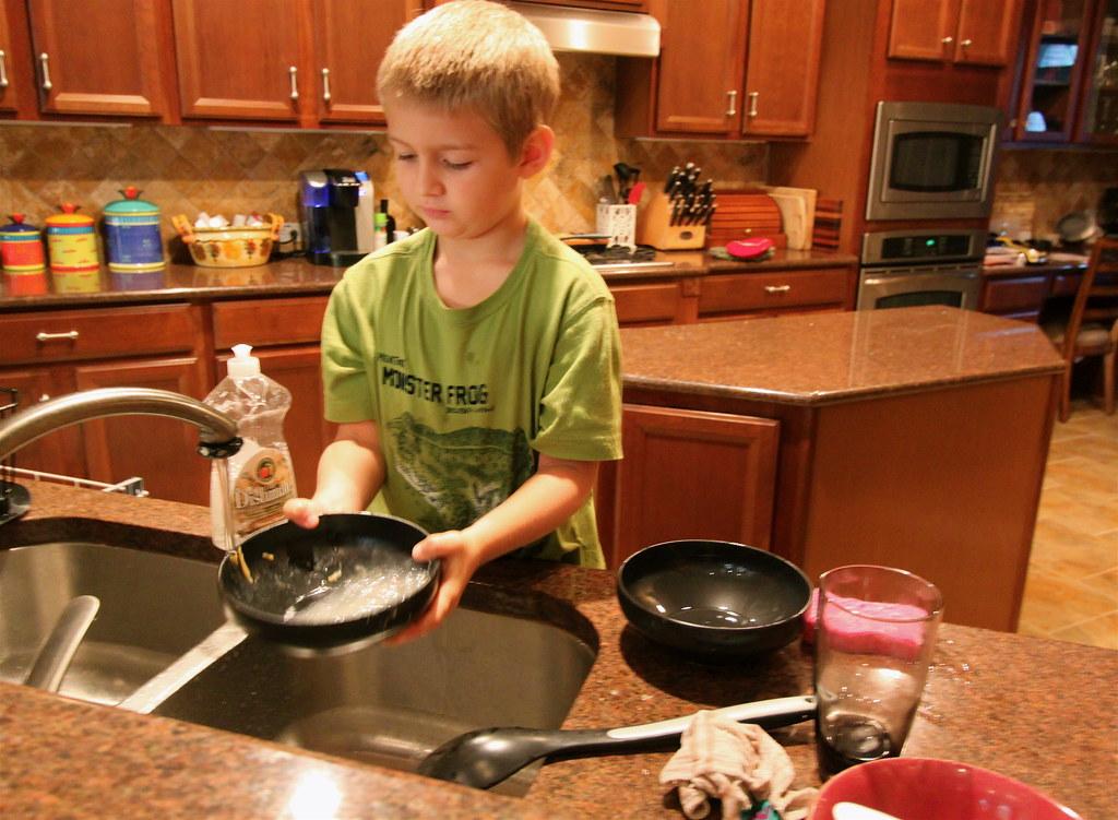 Gabriel rinses a bowl