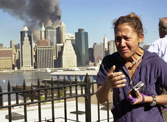 Woman reacts to collapse of World Trade Center while observing from the Brooklyn Promenade, by Kathy Willens