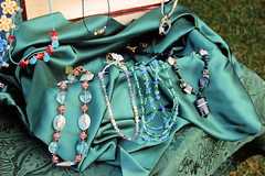 Paula's jewelry displayed on green satin