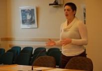 Julia Brown speaks in a legislative hearing room at the Maine State House in November 2011.