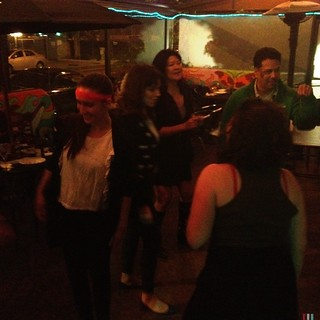 Everyone dancing at the awesome 80's party