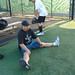 Players, who are UH employees at the various campuses by day, stretched to limber up for play in the UH AUW Softball Tourment at Les Murakami Stadium on Sept. 30, 2011