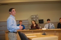 Adam Cohen speaks in a legislative hearing room at the Maine State House in November 2011