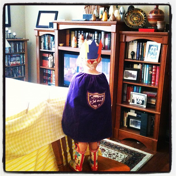 Living room fort and a cape. Best day ever.
