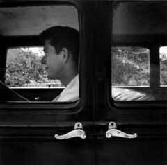 John Cage in car, Black Mountain, 1952, by Robert Rauschenberg