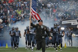 Military leading the Seahawks onto the field