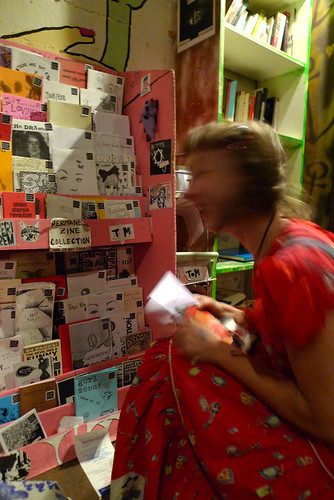 rhea sprucing up the zine library @ the smell