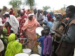 Refugees queue for water in the Jamam camp, So...