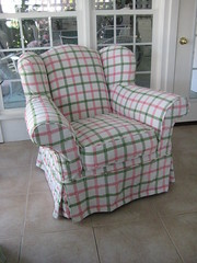 Overstuffed wing chair slip covered in plaid