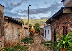 Day 397. Yesterday a student, Juan, saw me walking out of Neiva then later walking into his town. He stopped to talk and offered to help me find a hotel. Normally I'm on my guard, but Juan seemed earnest. We found a hotel, then he showed me around town, m