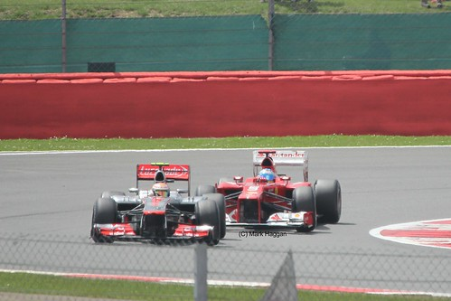 Fernando Alonso in his Ferrari racing with Lewis Hamilton in his McLaren at the 2012 British Grand Prix at Silverstone