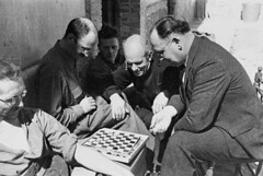 Dr. Norman Bethune (centre) watching a game of...