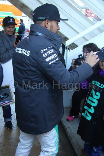 Lewis Hamilton signs autographs for some young fans at Formula One Winter Testing 2015