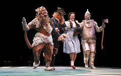 Jamie Torcellini as Cowardly Lion, Jim Walton as Scarecrow, Emily Walton as Dorothy, Shannon Stoeke as Tinman, and Nigel as Toto in The Wizard of Oz produced by Music Circus at the Wells Fargo Pavilion June 21 -30, 2013. Photo by Charr Crail.