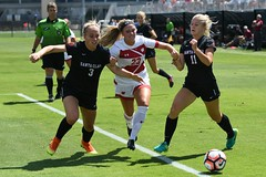 Stephanie Fabry of Wisconsin Badgers Women's Soccer team advancing against resistance from players of Santa Clara Broncos