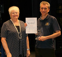Mary Williams presenting the John Williams trophy to the highest placed scaba band in B section