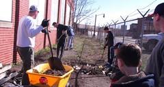 Volunteers work to clear debris