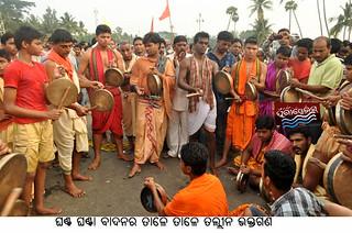 Playing Ghanta devotee enjoy the pious sound