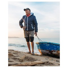 Day 1024 - A man is a police officer for thirty-two years. He works through the civil war. He retires. He moves to a house on the beach. In the afternoon he rows a kilometer over the ocean to catch his dinner. His friends catch dinner in their boats besid
