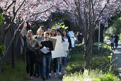 Kate Lyn Moussavian (front left) and Zoe Brydon (front right) lead the march of Los Altos High School students during a walkout as part of global action on climate change in Los Altos, California, United States on March 15, 2019