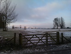 Snowy Firle Park gate with pond