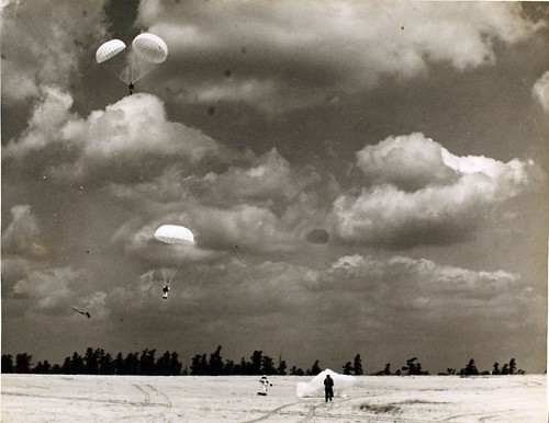 Parachutes landing, location unknown NHHS Photo by San Diego Air & Space Museum Archives