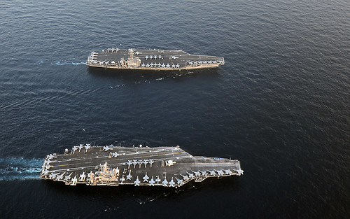 USS Abraham Lincoln and USS John C. Stennis join for a turnover of responsibility in the Arabian Sea. by Official U.S. Navy Imagery