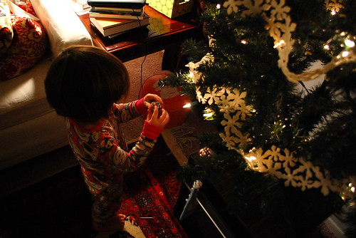 Putting up ornaments by herself.