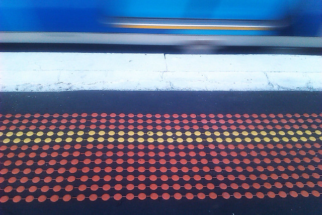 Create a photograph that features a repeating pattern - Platform at train station