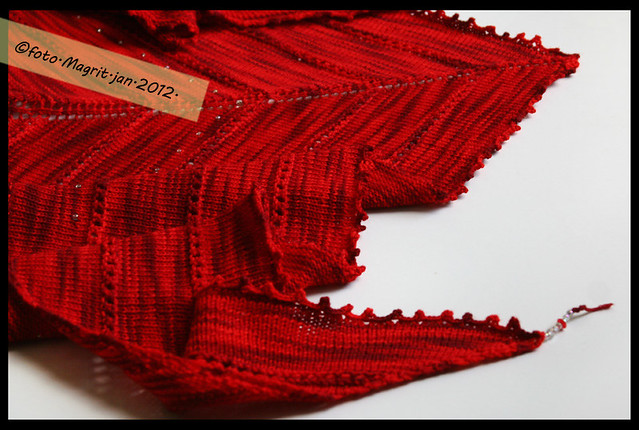 red triangular scarf detail