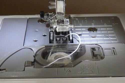 sewing machine needle hits bobbin