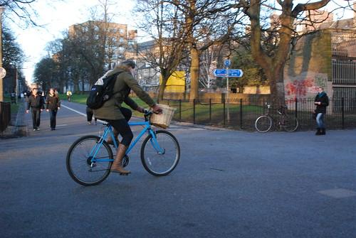 Green jacket, blue bike